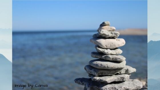 A stack of stones symbolizing meditation by the coast