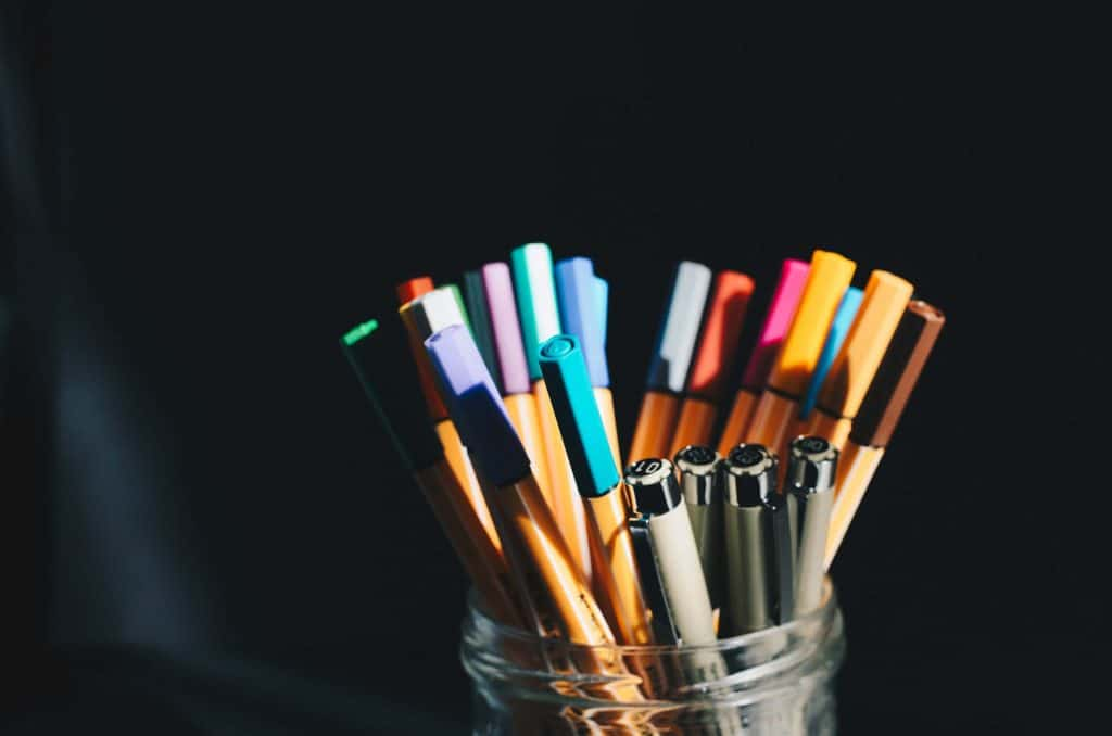 A jar filled with colorful pens. A Beginner's Guide to Journaling